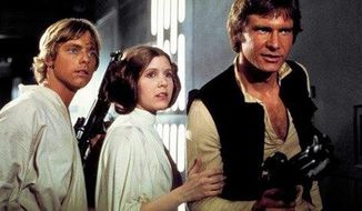 """This photo provided by Twentieth Century Fox Home Entertainment shows, Mark Hamill, from left, as Luke Skywalker, Carrie Fisher as Princess Leia Organa, and Harrison Ford as Hans Solo in the original 1977 """"Star Wars: Episode IV - A New Hope."""" The  four-day Star Wars Celebration kicked off Thursday, April 14, 2017 in Orlando, Fla., marking the 40-year anniversary of Lucas' space saga. (Twentieth Century Fox Home Entertainment via AP) ** FILE **"""