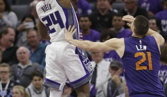 Sacramento Kings guard Buddy Hield, left, drives to the basket against Phoenix Suns center Alex Len during the second half of an NBA basketball game Tuesday, April 11, 2017, in Sacramento, Calif. The Kings won 129-104. (AP Photo/Rich Pedroncelli)