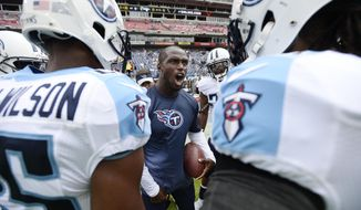 FILE - In this Sept. 27, 2015, file photo, Tennessee Titans cornerback Jason McCourty, center, pumps up teammates before an NFL football game against the Indianapolis Colts in Nashville, Tenn.  McCourty says that he is leaving the Tennessee Titans after spending his entire eight-year NFL career with the organization. McCourty shared the news Thursday, April 13, 2017, on a Twitter post. The Titans had no immediate comment.(AP Photo/Mark Zaleski, File)