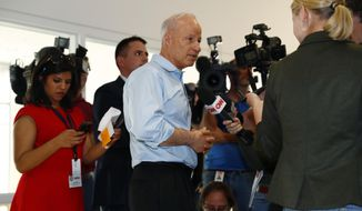 U.S. Rep. Mike Coffman, R-Colo., talks to reporters before addressing constituents during a town hall meeting in a hall on the campus of the University of Colorado Medical School late Wednesday, April 12, 2017, in Aurora, Colo. Town halls have become a risky proposition for GOP members of Congress since the election of President Donald Trump. (AP Photo/David Zalubowski)