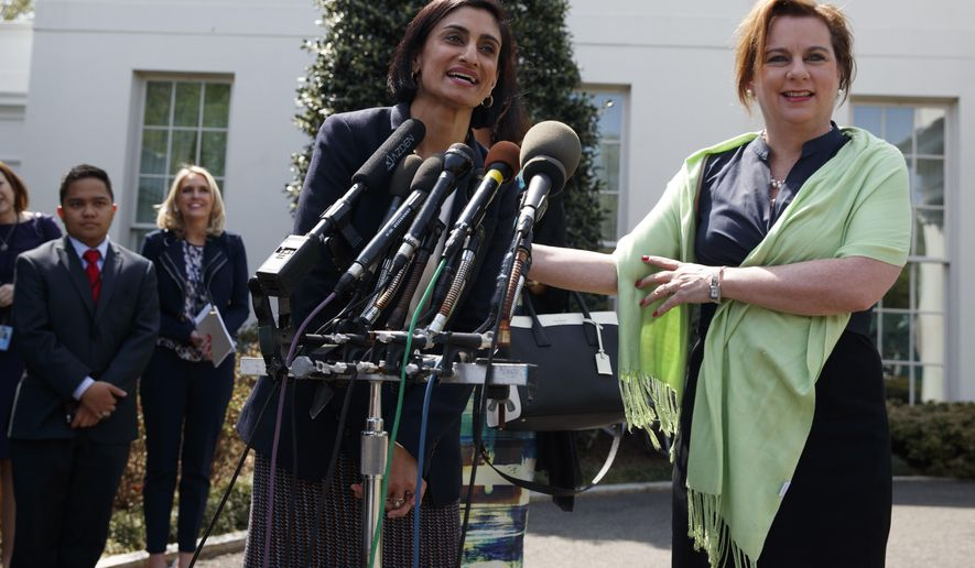 Marjorie Dannenfelser, president of the Susan B. Anthony List, right, listens as Seema Verma, administrator of the Centers for Medicare and Medicaid Services, speaks with reporters outside the White House in Washington, Thursday, April 13, 2017, after President Donald Trump signed signed H.J. Res. 43, which allows states to withhold federal funds from facilities that provide abortion services. (AP Photo/Evan Vucci)