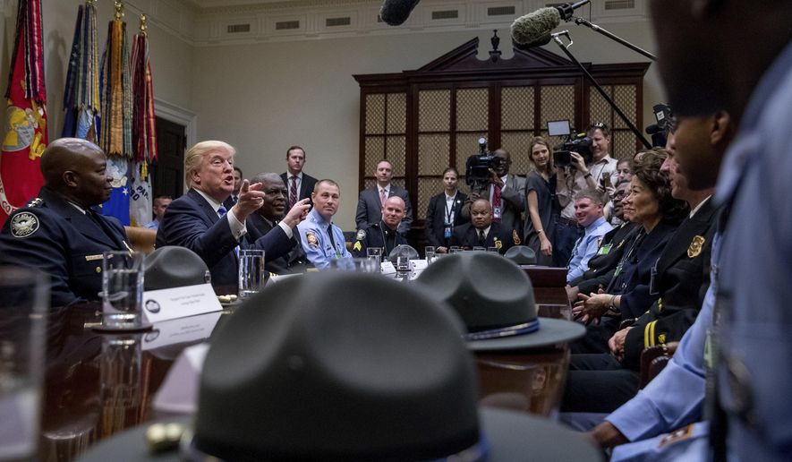 Transportation Secretary Elaine Chao, second from left, and others, listen during President Donald Trump's meeting with first responders from the I-85 bridge collapse in Atlanta, Thursday, April 13, 2017, in the Roosevelt Room in the White House in Washington. (AP Photo/Andrew Harnik)