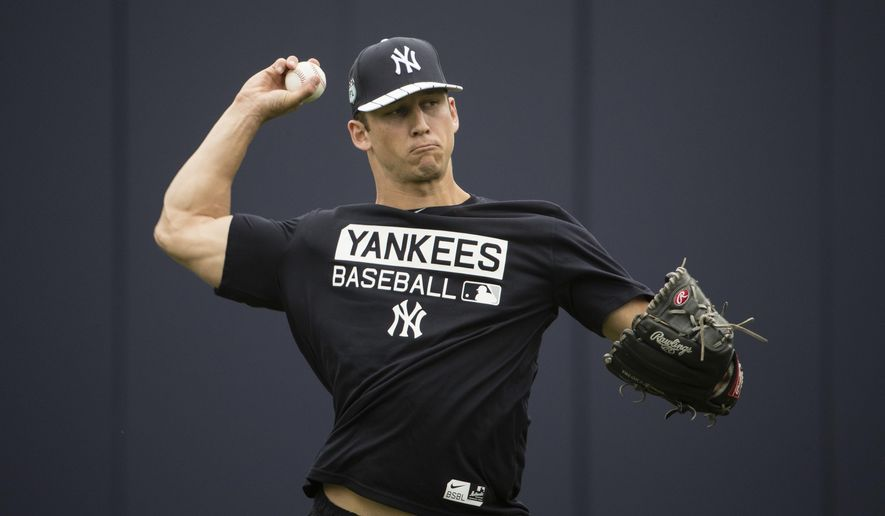 FILE - In this Feb. 14, 2017, file photo, New York Yankees James Kaprielian throws during a spring training baseball workout in Tampa, Fla. Top Yankees pitching prospect James Kaprielian will have Tommy John surgery next week and be sidelined until 2018. The team's announcement Thursday, April 13, 2017, didn't give details of the ligament damage. He'll have surgery on Tuesday. (AP Photo/Matt Rourke, File)