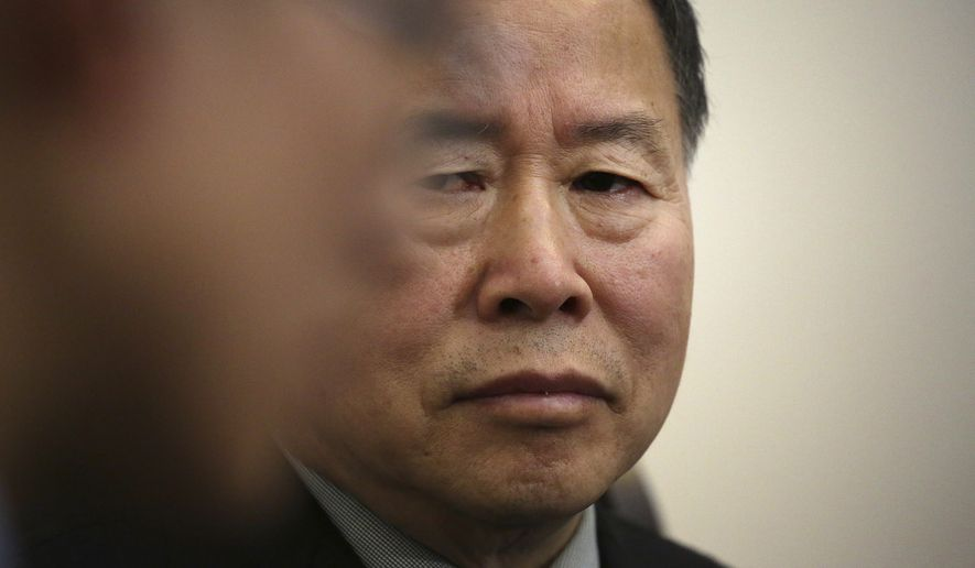 """Han Song Ryol, North Korea's vice foreign minister, listens to a translator during an interview with The Associated Press on Friday, April 14, 2017, in Pyongyang, North Korea. Han Song Ryol said the situation on the Korean Peninsula is now in a """"vicious cycle."""" (AP Photo/Wong Maye-E)"""