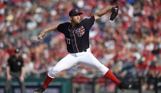 Washington Nationals starting pitcher Stephen Strasburg (37) winds up during the third inning of the team's baseball game against the Philadelphia Phillies, Friday, April 14, 2017, in Washington. (AP Photo/Nick Wass)