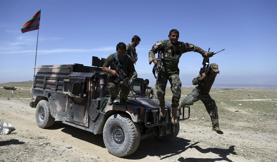Afghan commandos arrive at Pandola village near the site of a U.S. bombing in the Achin district of Jalalabad, east of Kabul, Afghanistan, Friday, April 14, 2017. U.S. forces in Afghanistan on Thursday struck an Islamic State tunnel complex in eastern Afghanistan with the largest non-nuclear weapon every used in combat by the U.S. military, Pentagon officials said. (AP Photo/Rahmat Gul)