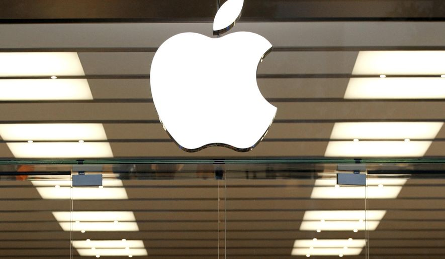 FILE - This Thursday, Sept. 19, 2013, file photo shows the Apple logo above a store location entrance, in Dallas. Apple will begin testing self-driving car technology in California, its first public move into a highly competitive field that could radically change transportation. The California Department of Motor Vehicles awarded Apple a permit to test autonomous vehicles Friday, April 14, 2017, and disclosed that information on its website. (AP Photo/Tony Gutierrez, File)
