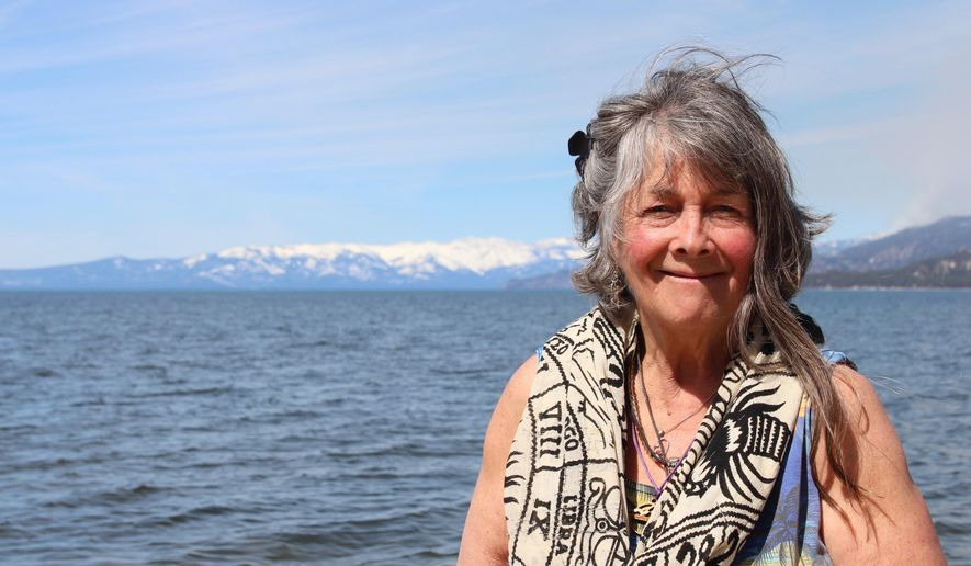 Carol Christensen, formerly Ferges, poses for a photo at El Dorado Beach in South Lake Tahoe, Calif., on Monday, April 3, 2017. Christensen, once a stunt double and acrobat, has become a fixture in South Lake Tahoe because of her mini-trampoline jumping and blowing of kisses to cars along Lake Tahoe Boulevard. (Claire Cudahy/Tahoe Daily Tribune via AP)