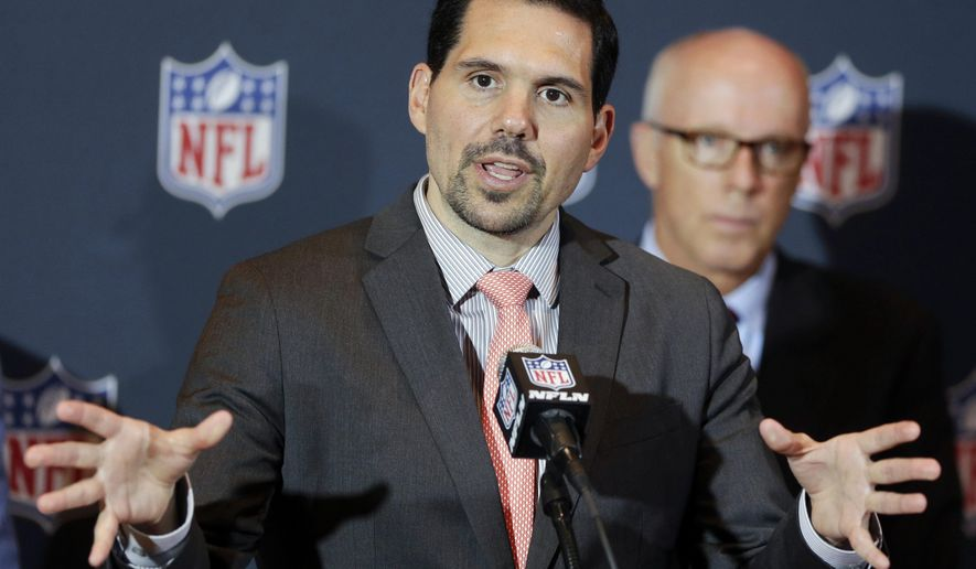 """FILE - In this Monday, March 24, 2014, file photo, NFL vice president of officiating Dean Blandino speaks during a news conference, while Atlanta Falcons President, CEO and NFL competition committee member Rich McKay, back right, listens, at the NFL football annual meeting in Orlando, Fla. Blandino, the NFL officiating director who has overseen rule changes that emphasized player safety, is leaving the league to spend more time with his family and explore other opportunities. """"Dean has done an outstanding job leading our officiating department,"""" Troy Vincent, the league's executive vice president of football operations said Friday, April 14, 2017, after informing the 32 teams of Blandino's departure.(AP Photo/John Raoux, File)"""