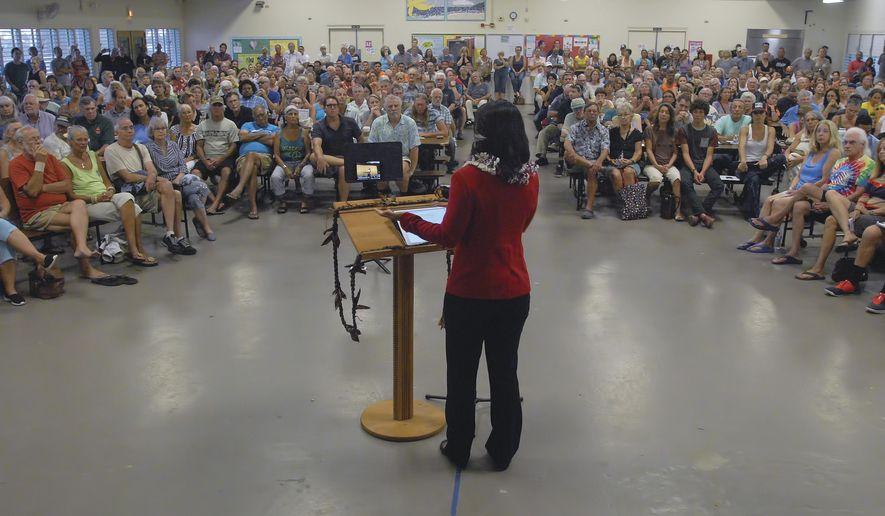 Representative Tulsi Gabbard speaks at the standing room only Kona Town Hall Meeting Tuesday, April 11, 2017, at Kealakehe Intermediate School in Kona, Hawaii. (Laura Ruminski/West Hawaii Today via AP)