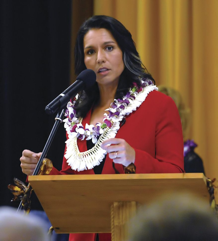 In this Tuesday, April 11, 2017, file photo, U.S. Rep. Tulsi Gabbard speaks at the Kona Town Hall Meeting at Kealakehe Intermediate School in Kona, Hawaii. (Laura Ruminski/West Hawaii Today via AP) ** FILE **
