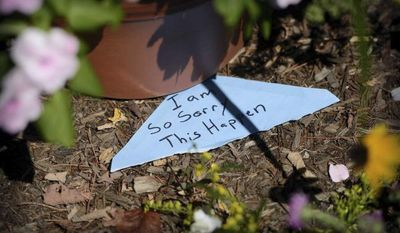 ADVANCE FOR SATURDAY, APRIL 15, 2017 - In this undated photo, a note expressing sympathy for the shooting death of Stacey Pennington rests on the ground in the Fairy Garden outside the Gretna Emporium gift shop, which Pennington owned, in Lebanon, Pa. (Michael K. Dakota /Lebanon Daily News via AP)