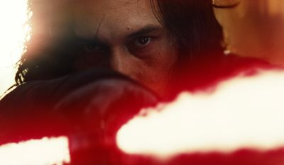 "This image released by Lucasfilm shows Adam Driver as Kylo Ren in a scene from the upcoming ""Star Wars: The Last Jedi,"" expected in theaters in December.  (Industrial Light & Magic/Lucasfilm via AP)"