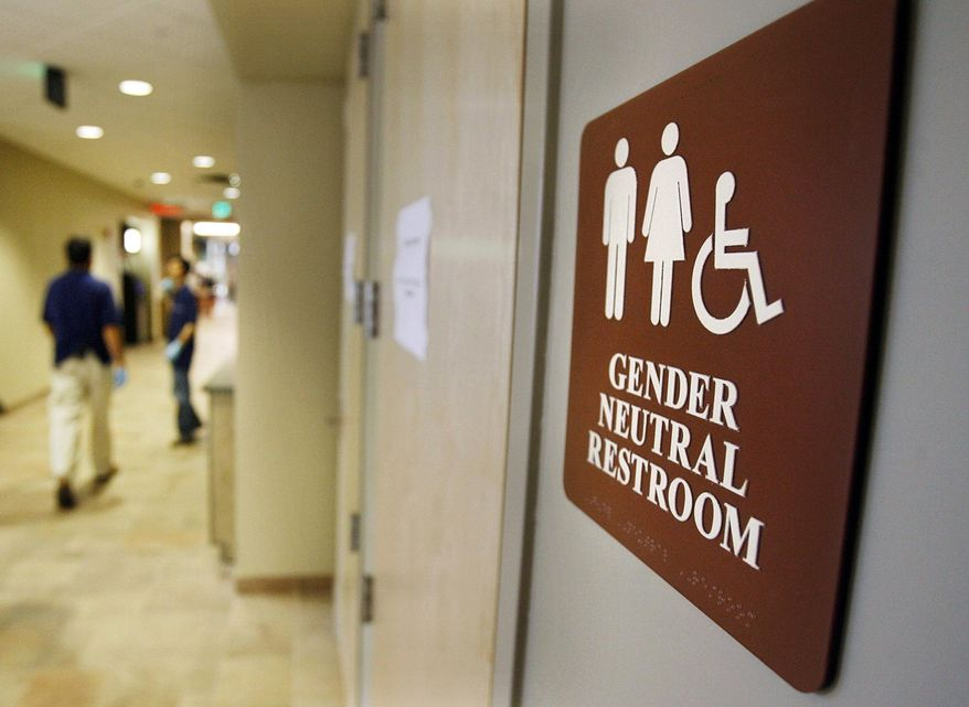 """FILE- In this Aug. 23, 2007, file photo, a sign marks the entrance to a gender-neutral restroom at the University of Vermont in Burlington, Vt. All public, single-use restrooms in Vermont would be designated """"gender-free"""" under a new measure gaining momentum in the House. The three-page bill is co-sponsored by nearly a quarter of Vermont's representatives and will get an afternoon of testimony on Tuesday, April 18, 2017. (AP Photo/Toby Talbot, File)"""
