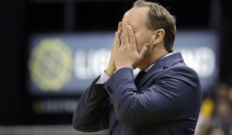 Atlanta Hawks coach Mike Budenholzer reacts to a turnover during the second half of the team's NBA basketball game against the Indiana Pacers, Wednesday, April 12, 2017, in Indianapolis. Indiana defeated Atlanta 104-86. (AP Photo/Darron Cummings)
