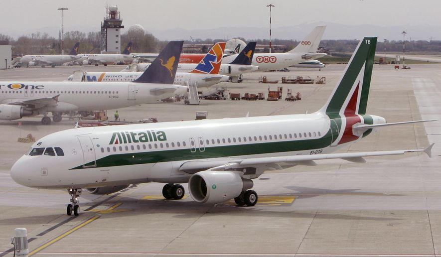 In this March 25, 2009 file photo, an Alitalia Airbus A320 is seen at the Linate airport in Milan.  (AP Photo/Antonio Calanni)