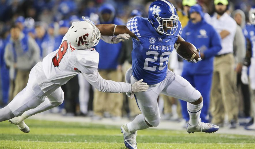 FILE - In this Nov. 19, 2016, file photo, Kentucky running back Benny Snell Jr. gets past the tackle of Austin Peay defensive back Trent Taylor to score a touchdown in the first half of an NCAA college football game, in Lexington, Ky. Snell seems ready for added responsibility following the departure of fellow 1,000-yard back Boom Williams to the NFL Draft. (AP Photo/David Stephenson, File)