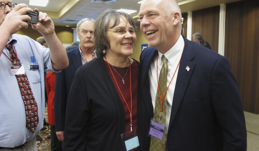 FILE - In this March 6, 2017 file photo, Greg Gianforte, right, receives congratulations from a supporter in Helena, Montana after winning the Republican nomination for Montana's special election for U.S. House. As the May 25 special election nears, critics say he's been hard to track on the stump because his schedule has not been well publicized by his campaign. (AP Photo/Matt Volz, File)