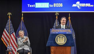 FILE - In this April 12, 2017 file photo provided by the Office of Governor Andrew M. Cuomo, Hillary Clinton applauds as Gov. Cuomo speaks from the podium at LaGuardia Community College in the Queens borough of New York during a ceremonial bill signing of the a first-in-the nation free tuition plan for students from middle-class families. Speculation Cuomo is plotting a run for president grew louder this week after his appearance with Hillary Clinton and budget plan some observers say reads like a map to the White House. (Darren McGee/Office of Governor Andrew M. Cuomo via AP, FIle)