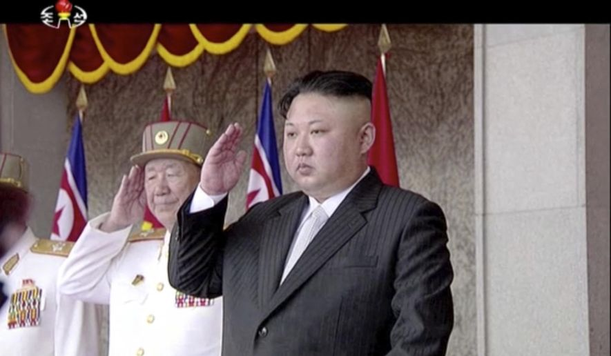In this image made from video broadcast by North Korean broadcaster KRT, North Korea's leader Kim Jong Un salutes during a parade at Kim Il Sung Square in Pyongyang, Saturday, April 15, 2017. North Korean leader Kim Jong Un has appeared in a massive parade in the capital, Pyongyang, celebrating the birthday of his late grandfather and North Korea founder Kim Il Sung. (KRT via AP)