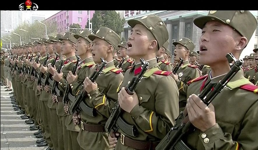 In this image made from video broadcast by North Korean broadcaster KRT, soldiers take part in a parade at Kim Il Sung Square in Pyongyang, Saturday, April 15, 2017. North Korean leader Kim Jong Un has appeared in a massive parade in the capital, Pyongyang, celebrating the birthday of his late grandfather and North Korea founder Kim Il Sung. (KRT via AP)