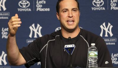 FILE - In this Aug. 5, 2016, file photo, New York Yankees' Mark Teixeira talks to reporters before a game in New York. Growing up, Mark Teixeira loved playing at a park. Now he wants those in an impoverished area to experience the same thing. The retired baseball star-turned-eco-athlete is lending his clout and wallet to a critical issue: preserving the environment. (AP Photo/Seth Wenig, File)