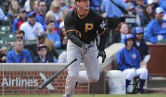 Pittsburgh Pirates third baseman David Freese (23) watches his RBI double during the second inning of a baseball game against the Chicago Cubs in Chicago, on Friday, April 14, 2017. (AP Photo/Jeff Haynes)
