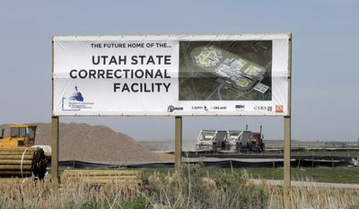 In this April 6, 2017, photo, a sign showing the future site of the Utah State Correction facility is displayed near the Salt Lake City International Airport. State officials say the new state prison is expected to be done by the end of 2020 as scheduled, but that inmates won't be moved there until the following year. Officials said Friday, April 14, 2017, during a Prison Development Commission hearing that it will take about six months to transition prisoners from the current facility in Draper to the new one about 25 miles north near the Salt Lake City International Airport. (AP Photo/Rick Bowmer)