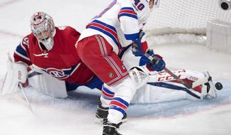 New York Rangers right wing Michael Grabner (40) scores the first goal against Montreal Canadiens goalie Carey Price (31) during first-period Game 2 NHL Stanley Cup first-round playoff hockey game action Friday, April 14, 2017, in Montreal. (Ryan Remiorz/The Canadian Press via AP)