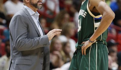 FILE - In this Jan. 21, 2017, file photo, Milwaukee Bucks coach Jason Kidd talks with forward Giannis Antetokounmpo during the team's NBA basketball game against the Miami Heat in Miami. Antetokounmpo blossomed into an All-Star in his first full season since Kidd made him a primary ball-handler. He became the first player in NBA history to finish a season in the top 20 in total points, rebounds, assists, blocks and steals.  (AP Photo/Wilfredo Lee, File)