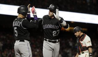 Colorado Rockies' Trevor Story (27) celebrates at the plate after driving in Carlos Gonzalez (5) with a two-run home run during the fourth inning of a baseball game, Thursday, April 13, 2017, in San Francisco. (AP Photo/Marcio Jose Sanchez)