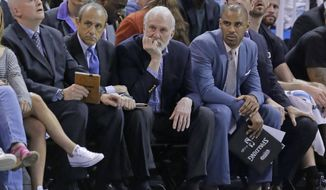 San Antonio Spurs head coach Gregg Popovich, center, looks on from the bench during the second half of an NBA basketball game against the Utah Jazz Wednesday, April 12, 2017, in Salt Lake City. The Jazz won 101-97. (AP Photo/Rick Bowmer)