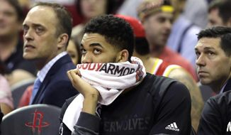 Minnesota Timberwolves' Karl-Anthony Towns watches from the bench during the second half of an NBA basketball game against the Houston Rockets, Wednesday, April 12, 2017, in Houston. The Rockets won 123-118. (AP Photo/David J. Phillip)
