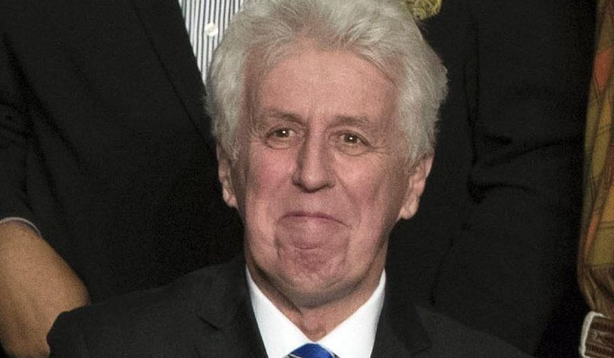 """FILE - In this Dec. 15, 2016, photo, CNN commentator Jeffrey Lord, appears at a rally for President-elect Donald Trump in Hershey, Pa. Lord made a comparison of Trump to Martin Luther King Jr., on CNN's morning """"New Day.""""  He is one of a handful of pro-Trump commentators that CNN hired during the last election. (AP Photo/Matt Rourke, File)"""