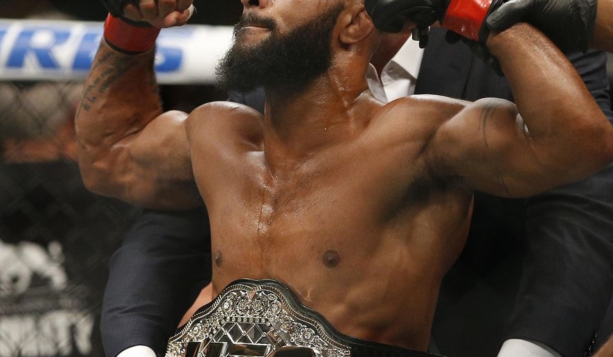 FILE - In this Sept. 5, 2015, file photo, Demetrious Johnson celebrates after defeating John Dodson in a flyweight title mixed martial arts bout at UFC 191 in Las Vegas. Johnson will again defend his flyweight title against Brazilian Wilson Reis in the main event at Sprint Center, the first time the UFC has ventured into Kansas City.(AP Photo/John Locher, File)