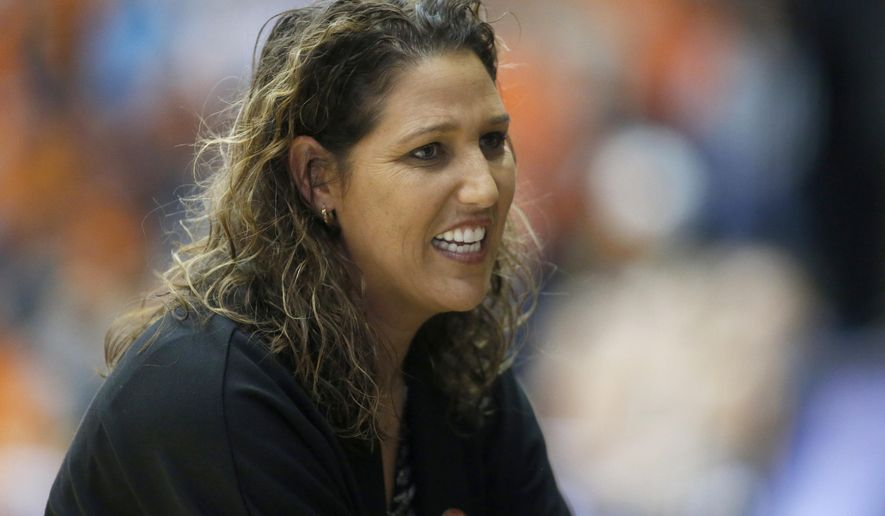 FILE - In this March 17, 2017, file photo, Long Beach State head coach Jody Wynn watches during a first-round game in the women's NCAA college basketball tournament, in Corvallis, Ore. Washington has hired Wynn as the women's basketball coach to replace Mike Neighbors, who guided the team to the Final Four in 2016. Washington athletic director Jennifer Cohen announced the decision on Friday, April 14, 2017.(AP Photo/ Timothy J. Gonzalez, File)