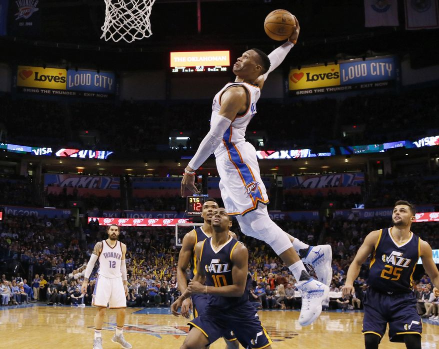 FILE - In this Saturday, March 11, 2017, file photo, Oklahoma City Thunder guard Russell Westbrook, center, goes up for a dunk in front of Utah Jazz guards Alec Burks (10) and Raul Neto (25) during an NBA basketball game in Oklahoma City. Westbrook had more triple-doubles than any player in history this season, and he'll need a few more if Oklahoma City expects to make a deep playoff run. (AP Photo/Sue Ogrocki, File)