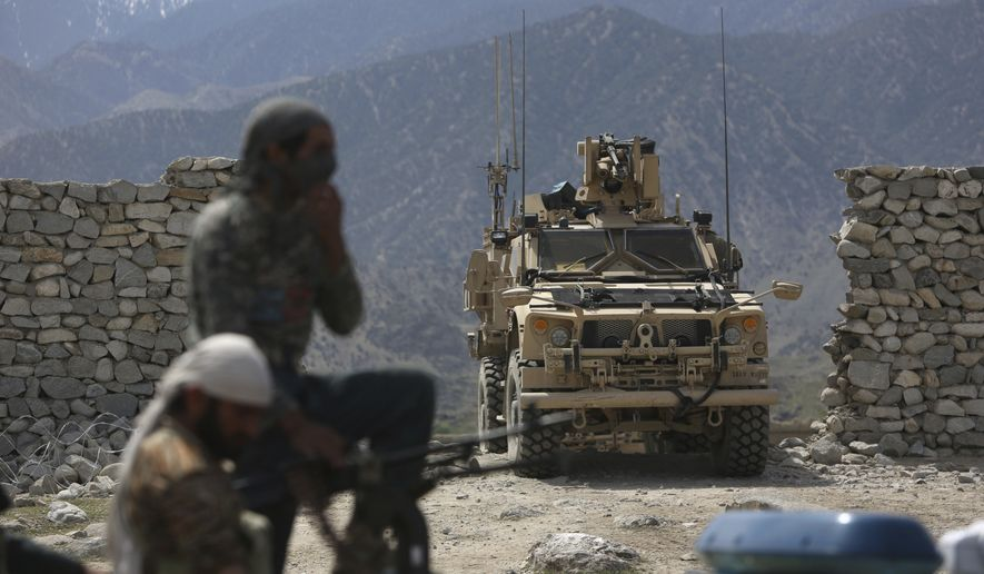 U.S. forces and Afghan security police are seen in Asad Khil near the site of a U.S. bombing in the Achin district of Jalalabad, east of Kabul, Afghanistan, Saturday, April 17, 2017. U.S. forces in Afghanistan on Thursday struck an Islamic State tunnel complex in eastern Afghanistan with the largest non-nuclear weapon every used in combat by the U.S. military, Pentagon officials said. (AP Photo/Rahmat Gul)