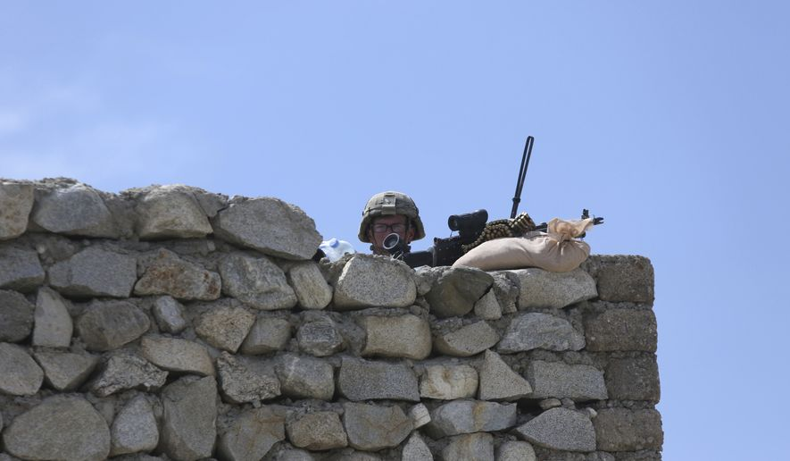U.S. soldier stand guard in Asad Khil near the site of a U.S. bombing in the Achin district of Jalalabad, east of Kabul, Afghanistan, Saturday, April 17, 2017. U.S. forces in Afghanistan on Thursday struck an Islamic State tunnel complex in eastern Afghanistan with the largest non-nuclear weapon every used in combat by the U.S. military, Pentagon officials said. (AP Photo/Rahmat Gul)