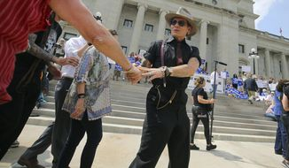 Actor Johnny Depp attended a rally Friday at the Capitol in Little Rock opposing Arkansas' execution set to begin this week. (Associated Press)