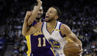 Golden State Warriors' Stephen Curry (30) is fouled by Los Angeles Lakers' Tyler Ennis (11) during the second half of an NBA basketball game Wednesday, April 12, 2017, in Oakland, Calif. (AP Photo/Marcio Jose Sanchez)
