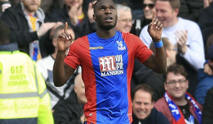 Crystal Palace's Christian Benteke celebrates scoring his side's second goal of the game during their English Premier League soccer match against Leicester City at Selhurst Park, London, Saturday, April 15, 2017. (Adam Davy/PA via AP)