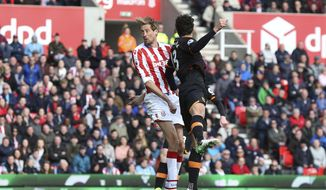 Stoke City's Peter Crouch scores his side's second goal of the game during the Premier League soccer match between Stoke City and Hull City at the bet365 Stadium, Stoke, England. Saturday April 15, 2017. (Barrington Coombs/PA via AP)
