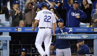 Los Angeles Dodgers starting pitcher Clayton Kershaw walks off the field to a standing ovation after being taken out of the baseball game against the Arizona Diamondbacks during the ninth inning, Friday, April 14, 2017, in Los Angeles. (AP Photo/Mark J. Terrill)
