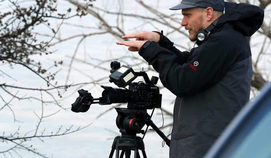 In this Thursday, March 23, 2017 photo, Jarkko Virtanen of Helsinki, Finland, lines up a video scene along the Platte River in Wood River, Neb. (David Hendee/Omaha World-Herald via AP)