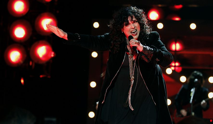 """FILE - In this Dec. 3, 2010, file photo, Ann Wilson of the band Heart performs onstage at the """"Vh1 Divas Salute the Troops"""" on in San Diego, Calif. The husband of Heart lead singer Ann Wilson has been sentenced for allegedly choking her nephews during a concert in suburban Seattle. Seattlepi.com reported Friday, April 14, 2017, that Dean Wetter pleaded guilty March 9 to two counts of assault. He was sentenced as part of a plea deal to 364 days in jail, with all the time suspended.  (AP Photo/Matt Sayles, File)"""