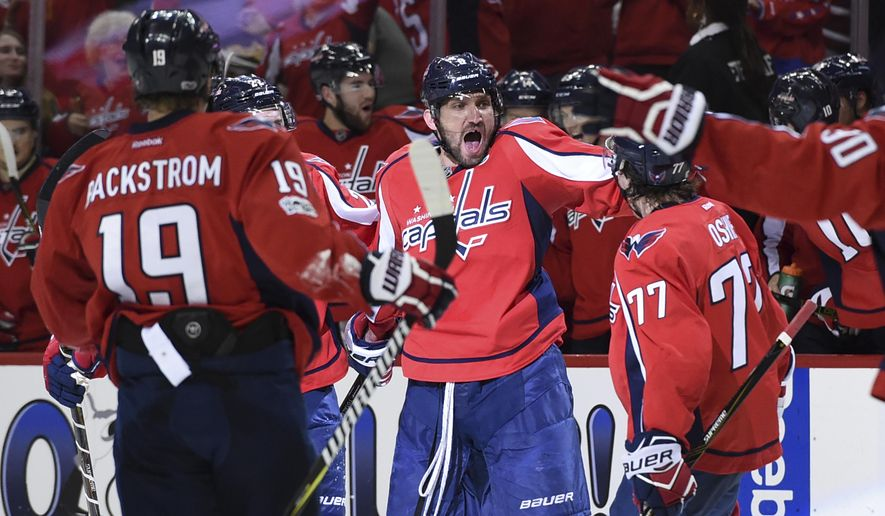Washington Capitals left wing Alex Ovechkin (8) celebrates his goal with center Nicklas Backstrom (19) and right wing T.J. Oshie (77) against the Toronto Maple Leafs during the second period in Game 2 of an NHL Stanley Cup first-round playoff series in Washington, Saturday, April 15, 2017. (AP Photo/Molly Riley)