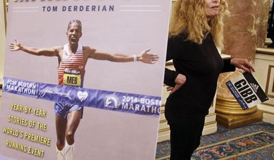 Bobbi Gibb is interviewed by a reporter separately after a media availability at the Copley Plaza Hotel near the Boston Marathon finish line Thursday, April 13, 2017, in Boston. As an unregistered runner Gibb was the first woman ever to run the Boston Marathon in 1966. (AP Photo/Stephan Savoia)