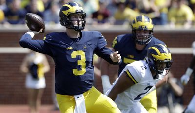 Michigan quarterback Wilton Speight (3) throws during the NCAA college football team's spring game Saturday, April 15, 2017, in Ann Arbor, Mich. (AP Photo/Carlos Osorio)