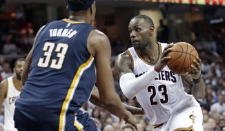 Cleveland Cavaliers' LeBron James (23) drives past Indiana Pacers' Myles Turner (33) in the first half in Game 1 of a first-round NBA basketball playoff series, Saturday, April 15, 2017, in Cleveland. (AP Photo/Tony Dejak)